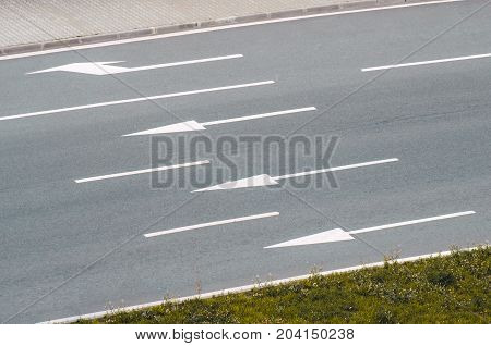 Asphalt Road And Three Lanes With Markings And Arrows