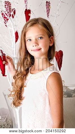Adorable smiling little girl child in princess dress