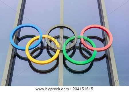 Lausanne Switzerland - May 25 2016: Olympic rings at Olympic museum in Switzerland. The symbol of the Olympic Games was originally designed in 1912 by Baron Pierre de Coubertin.