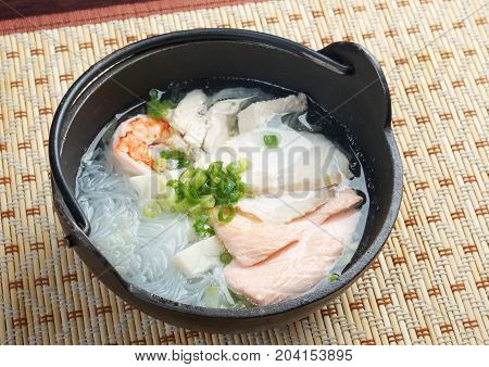 chinese traditional seafood noodle soup. Shallow depth-of-field.