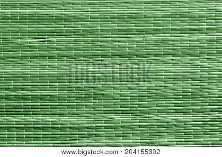 Green Color Straw Mat Surface.