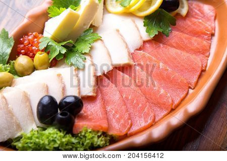 Fish plate with salmon and halibut. Assorted fish on a plate