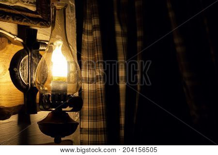 Old lamp with fire. Romantic background .