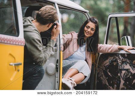 Couple Taking Photo In Minivan