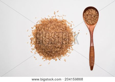 Red Rice With A Wooden Spoon Close Up