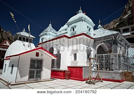 White stoned Indian temple in Gangotri. Uttarakhand Nord India.