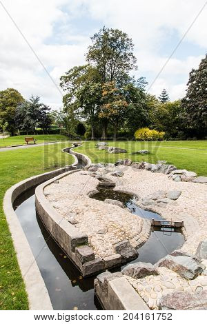Swadlincote Park Derbyshire water and stone feature. water chanel rock feature with stone and pebble inlays.