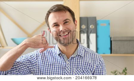 Call Me For Help, Gesturing Man At Work In Office
