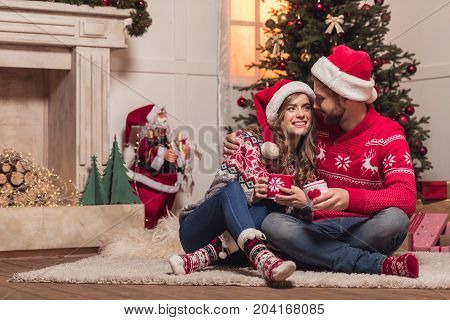 Couple With Cups At Christmastime