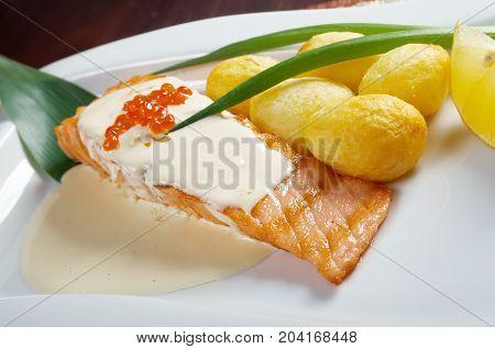 Salmon with potato .cream sauce. Shallow depth-of-field