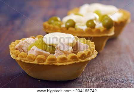 Tartlet With Salad On Wooden Board