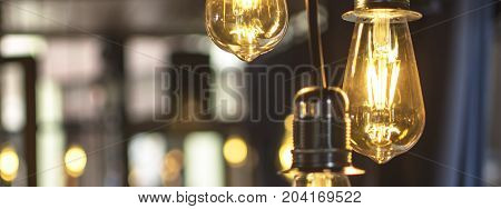 Old Style Glowing Light Bulbs Hanging in Bar