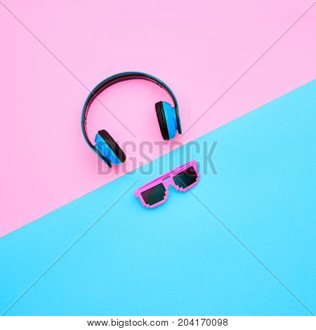 Minimal. Headphones and Trendy fashion Sunglasses. Music vibration. Hipster DJ Accessories Set. Art Creative Summer Vibes. Sweet color. Top view