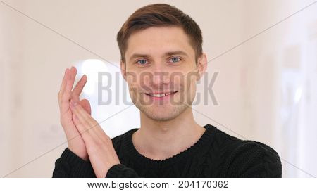 Portrait Of Applauding, Clapping Man Sitting In Office