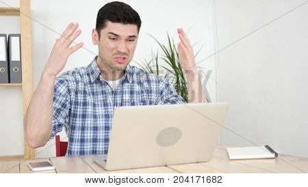Working Man Reacting To Problems And Failure At Work In Office