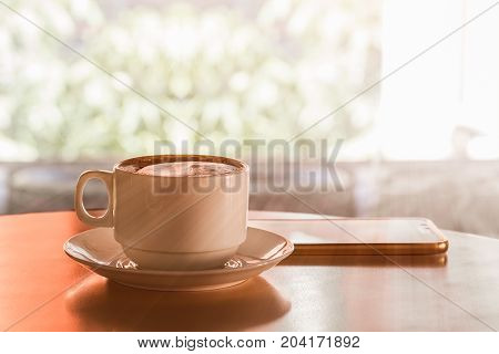 Cup Of Hot Coffee On Wood Table