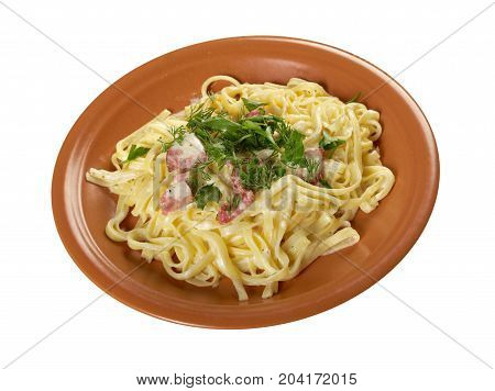 pasta Fettuccine Alfredo with sausage. close-up. isolated