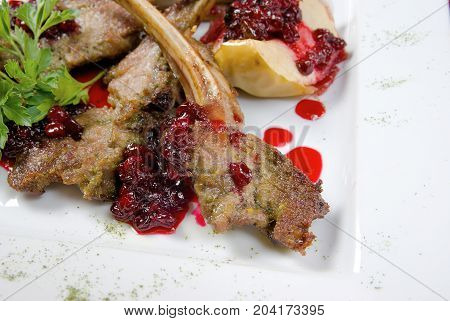 Meat Lamb On Rib With Cowberries By Sauce