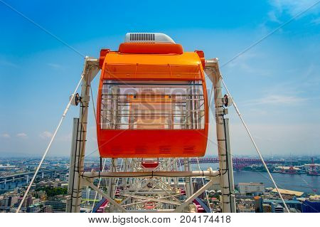 OSAKA, JAPAN - JULY 18, 2017: Close up of Tempozan Ferris Wheel in Osaka, Japan. The wheel has a height of 112.5 metres, it's opened in 1997, situated in Tempozan Harbor Village.