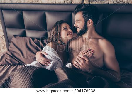 Close Up Cropped Photo Of Stunning Young Sexy Brunette Embracing Her Lover In Bed, He Is Bearded Han