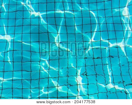 Blue water in the pool with light