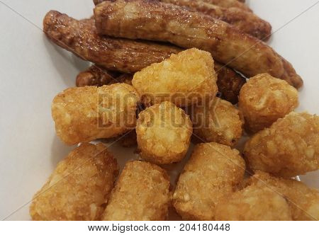 many sausages and potatoes in the form of tater tots