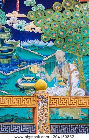 Punakha, Bhutan - September 10, 2016: Painting Of A Benevolent Contemplative Sage And Symbols Of Lon