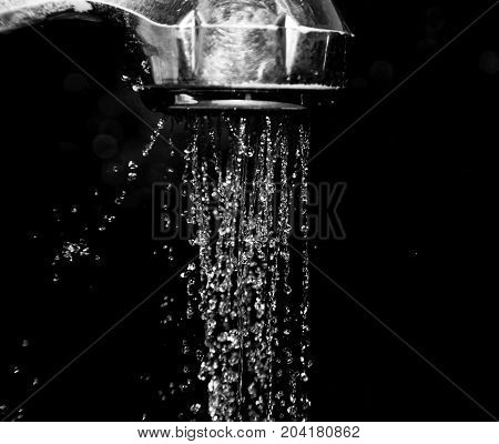 Shower with water isolated on a black background