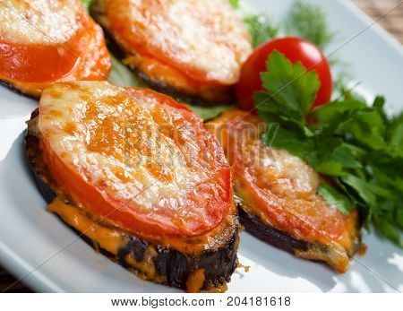 roasted tomato and eggplant.  Shallow depth-of-field. close up traditional meal