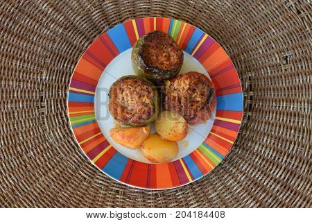 Stuffed tomato and green peppers with rice and potatoes. Greek food gemista.