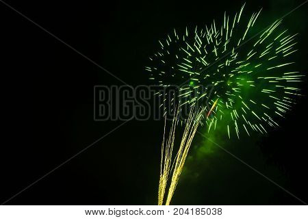 Green firework. Amazing fireworks, fireworks 2017, fireworks background, fireworks event, Fireworks Festival, firework, fireworks isolated, fireworks night, beautiful, colorful. Celebration symbol.