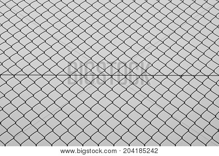 Chain link fencing iron wire mesh silhouette background texture. Abstract pattern black and white.