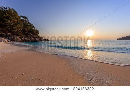 Sunrise in Marble beach (Saliara beach) Thassos Islands Greece. The most beautiful white beach in Greece