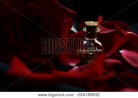 vessel with the water perfume of the fragrance of red roses