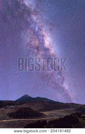 The milky way in night sky over Mount Bromo volcano (Gunung Bromo) in Bromo Tengger Semeru National Park East Java Indonesia..