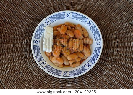 Gigantes giant beans with carrots and feta cheese. Greek food.
