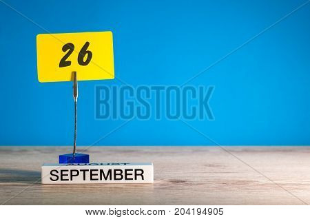 September 26th. Day 26 of month, Calendar on teacher or student, pupil table with empty space for text, copy space.