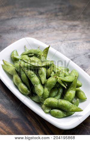 portion of salted japanese edamame green beans snack starter