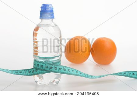 Water Bottle Wrapped With Measure Tape And Fruit