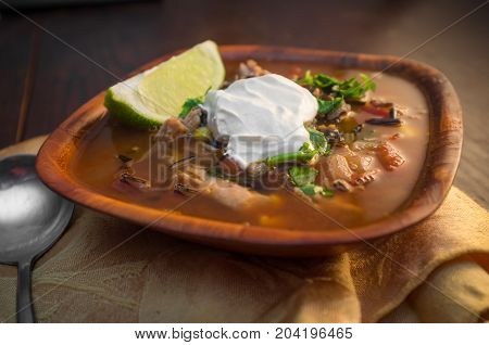 Fresh hot South American Aztec soup with cream and lime