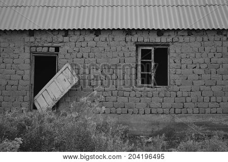 old abandoned house in black and white photography