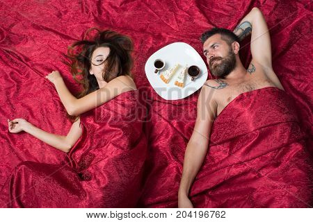 Man And Woman With Half Covered Bodies Lie In Bedroom