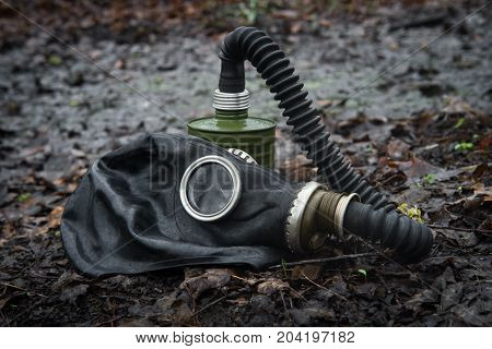 Scary authentic Russian gas mask with breathing hose abandoned in woods