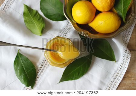 Lemon Curd In A Glass Jar, Lemons And Lemon Leaves. Rustic Style, Selective Focus.