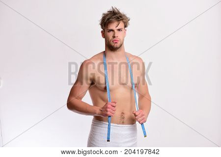 Man With Blue Measuring Tape On Neck. Guy With Towel