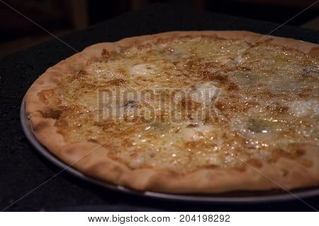 fatty oil cheese pizza in tray high fat meal fat disease
