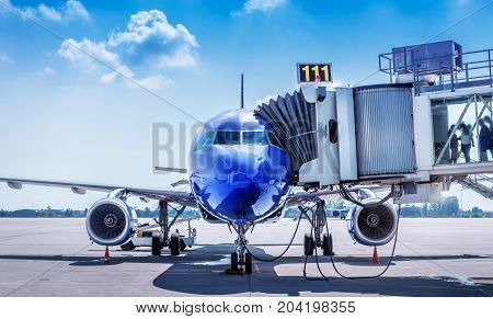 blue aircraft gets prepared for take off
