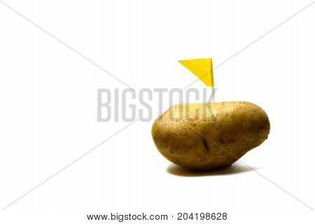 A New Fresh Potato With Yellow Flag On White Background Isolated
