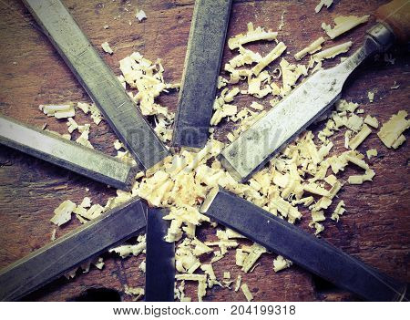 Blade Of Sharp Chisels With Sawdust And Vintage Effect