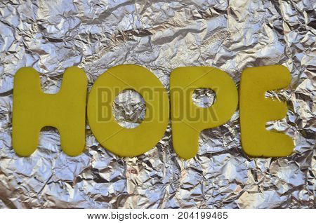WORD HOPE ON A  ABSTRACT SILVER BACKGROUND